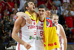 Semih Erden of Turkey and Ersan Ilyasova of Turkey celebrate after the quarter-final basketball match between National teams of Turkey and Slovenia at 2010 FIBA World Championships on September 8, 2010 at the Sinan Erdem Dome in Istanbul, Turkey.  Turkey defeated Slovenia 95 - 68. (Photo By Vid Ponikvar / Sportida.com)