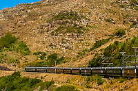 The luxury Rovos Rail train from Pretoria to Cape Town, South Africa travels through the Cape Winelands as it nears Cape Town.