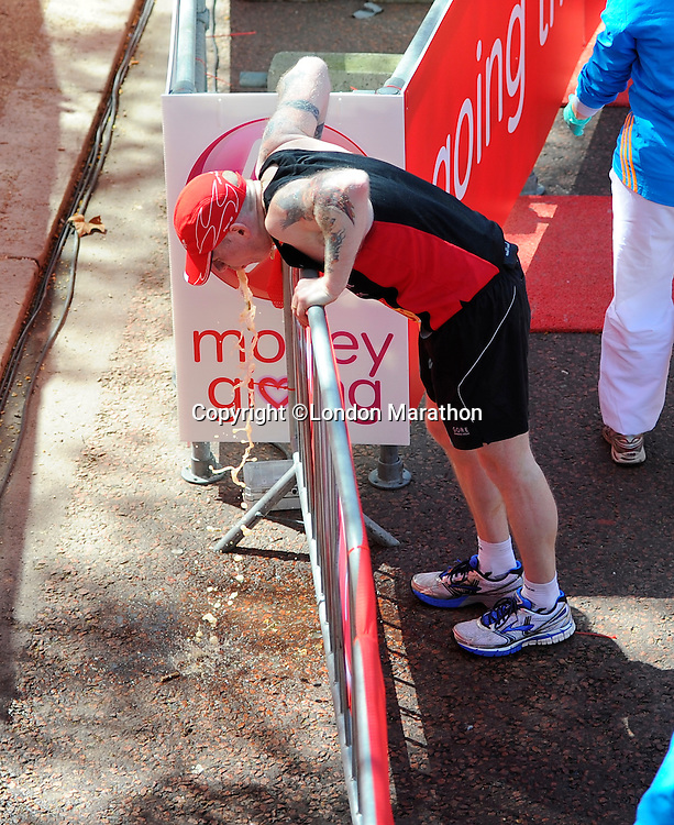 A runner vomits<br /> The Virgin Money London Marathon 2014<br /> 13 April 2014<br /> Photo: Javier Garcia/Virgin Money London Marathon<br /> media@london-marathon.co.uk