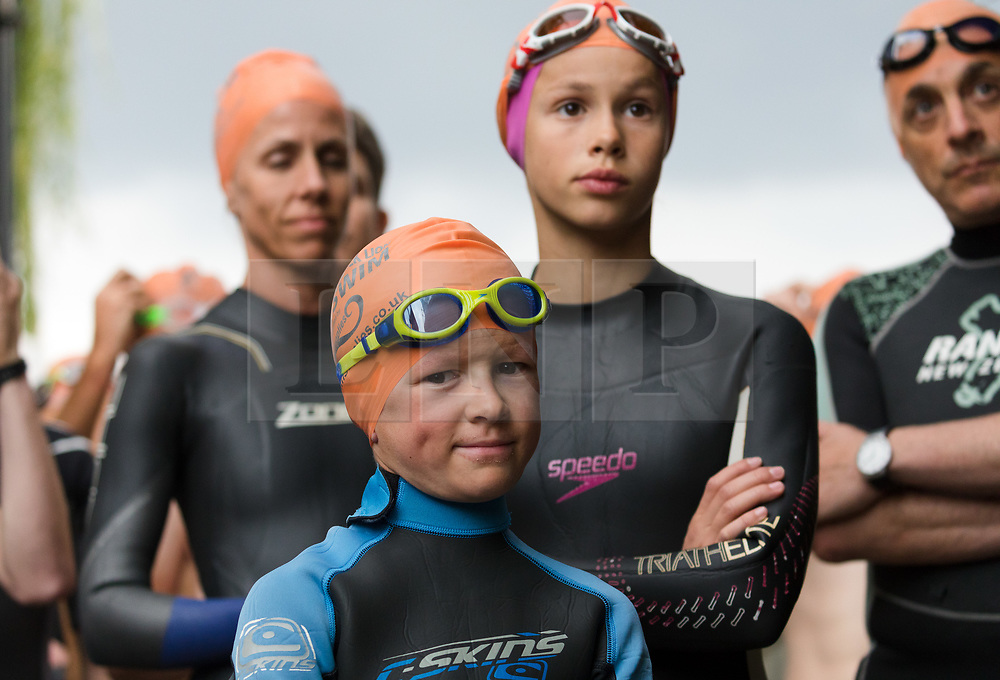 © Licensed to London News Pictures. 31/08/2018. London, UK.  Participants, including Wilf Pryor, aged 8 (centre) prepare to take part in the Tidal River Swim in Hammersmith this evening, launching this years Thames Festival. Over 100 brave enthusiasts took part in a 30 minute swim, as they followed the tide towards Chiswich Eycot and back. Photo credit: Vickie Flores/LNP