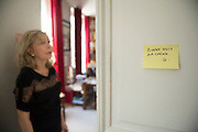 "March 6, 2015, Paris, France. Maryse Wolinski (1943, Algiers) standing beside a post-it note of her assassinated husband Georges Wolinski. Post-it notes still decorate the Paris' apartment where Georges and Maryse Wolinski used to live. French Cartoonist Georges Wolinski (1934 –2015) wrote daily post-it notes to his wife Maryse Wolinski. Two month after the death of Georges Wolinski, the apartment is full of souvenirs and notes, attesting a half-century-long love relation: ""Good night my darling. G."" <br /> The cartoonist Georges Wolinski was 80 years old when he was murdered by the French jihadists Chérif en Saïd Kouachi, he was one of the 12 victims of the massacre in the Charlie Hebdo offices on January 7, 2015 in Paris. Charlie Hebdo published caricatures of Mohammed, considered blasphemous by some Muslims. During his life, Georges Wolinski defended freedom, secularism and humour and was one of the major political cartoonists in France. The couple was married and had lived for 47 years together. Photo: Steven Wassenaar."