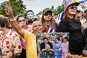 04 AUGUST 2013 - BANGKOK, THAILAND: Protesters shout anti-Thaksin Shinawatra slogans at an anti-government rally in Bangkok. About 2,000 people, members of the  People's Army against Thaksin Regime, a new anti-government group, protested in Lumpini Park in central Bangkok. The protest was peaceful but more militant protests are expected later in the week when the Parliament is expected to debate an amnesty bill which could allow Thaksin Shinawatra, the exiled former Prime Minister, to return to Thailand.      PHOTO BY JACK KURTZ