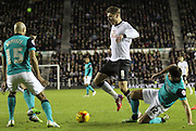 Jeff Hendrick takes on Ben Marshall and Alex Baptiste during the Sky Bet Championship match between Derby County and Blackburn Rovers at the iPro Stadium, Derby, England on 27 January 2015. Photo by Jodie Minter.