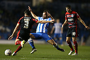 Inigo Calderon, Brighton defender tackles James during the Sky Bet Championship match between Brighton and Hove Albion and Huddersfield Town at the American Express Community Stadium, Brighton and Hove, England on 14 April 2015.