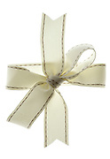 close up of a white gift wrap bow ribbon
