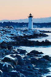 Portsmouth Harbor lighthouse in New Castle, New Hampshire. Dawn. Winter.