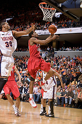 Maryland guard Adrian Bowie (22) shoots a layup past Virginia forward Adrian Joseph (30).  The Virginia Cavaliers defeated the Maryland Terrapins 91-76 at the University of Virginia's John Paul Jones Arena  in Charlottesville, VA on March 9, 2008.