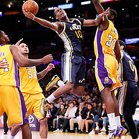 19 October 2014: Utah Jazz guard Alec Burks (10) goes for the layup against Los Angeles Lakers forward Julius Randle (30) during the Los Angeles Lakers 98-91 victory over the Utah Jazz, in a preseason game, at the Staples Center, Los Angeles, California, USA.
