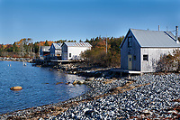 Fishermans huts on edge of bay,   Broad Cove river, Nova Scotia, Canada