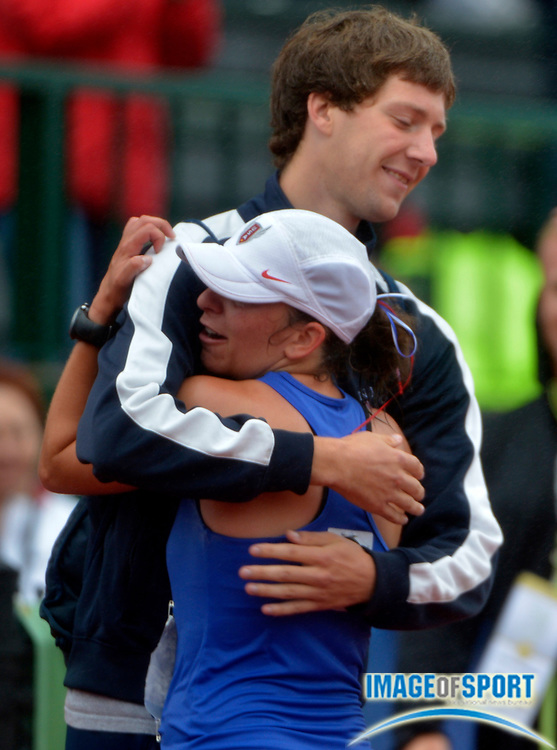 Jul 1, 2012; Eugene, OR, USA; Miranda Melville (right) is embraced by Trevor Barron after finishing second in the womens 20K race walk in 1:34.56 during the 2012 U.S. Olympic Team Trials at Hayward Field.