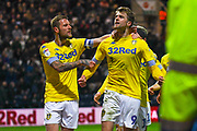 Patrick Bamford of Leeds United (9) scores a goal and celebrates with Liam Cooper of Leeds United (6) to make the score 0-1 during the EFL Sky Bet Championship match between Preston North End and Leeds United at Deepdale, Preston, England on 9 April 2019.
