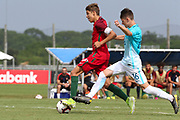 Portugal midfielder Diogo Prioste (8) dribbles away from Slovenia forward Denis Leban (16) during a CONCACAF boys under-15 championship soccer game, Sunday, August 11, 2019, in Bradenton, Fla. Portugal defeated Slovenia in the final in 2-0. (Kim Hukari/Image of Sport)