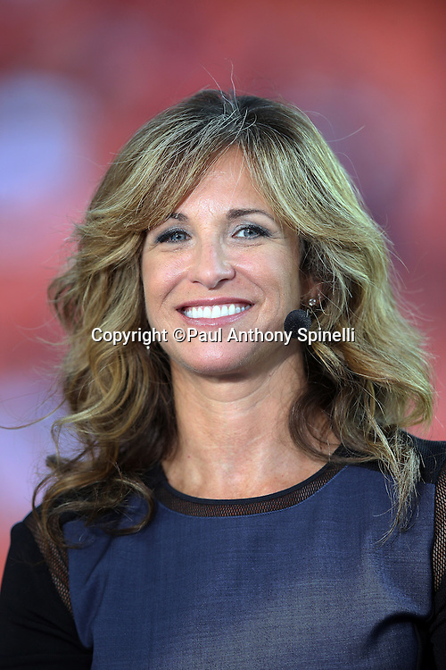 Television football analyst Suzy Kolber appears on the ESPN sideline set at the Kansas City Chiefs NFL week 4 regular season football game against the New England Patriots on Monday, September 29, 2014 in Kansas City, Mo. The Chiefs won the game 41-14. ©Paul Anthony Spinelli
