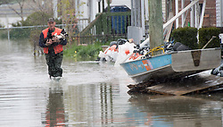 Andre Belanger carries his dog Rocky through floodwaters, Monday May 8, 2017 in Gatineau, Quebec, Canada. Photo by Adrian Wyld /The Canadian Press/ABACAPRESS.COM