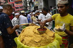 May 28, 2017 - Dhaka, Bangladesh - Vendor waits with foods for customers in the traditional Ifter market at Chalk Bazar as the first day of the Holy month Ramadan in Dhaka, Bangladesh. On May 28, 2017. (Credit Image: © Str/NurPhoto via ZUMA Press)