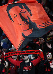 A Ostersunds FK fan shows his support in the stands prior to the match