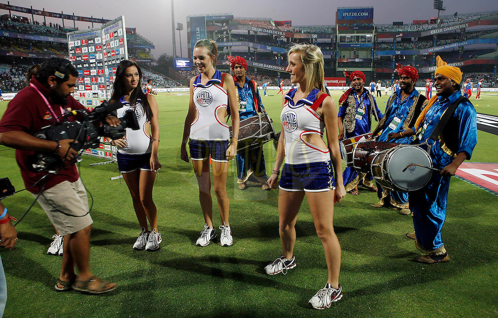 A cameraman shoots cheer girls during match 30 of the Indian Premier League ( IPL ) Season 4 between the Delhi Daredevils and the Royal Challengers Bangalore held at the Feroz Shah Kotla Stadium in Delhi, India on the 26th April 2011..Photo by Money Sharma/BCCI/SPORTZPICS