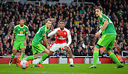 Arsenal Forward Alex Iwobi, \20\ and Sunderland Defender Sebastian Coates during the The FA Cup match between Arsenal and Sunderland at the Emirates Stadium, London, England on 9 January 2016. Photo by Adam Rivers.