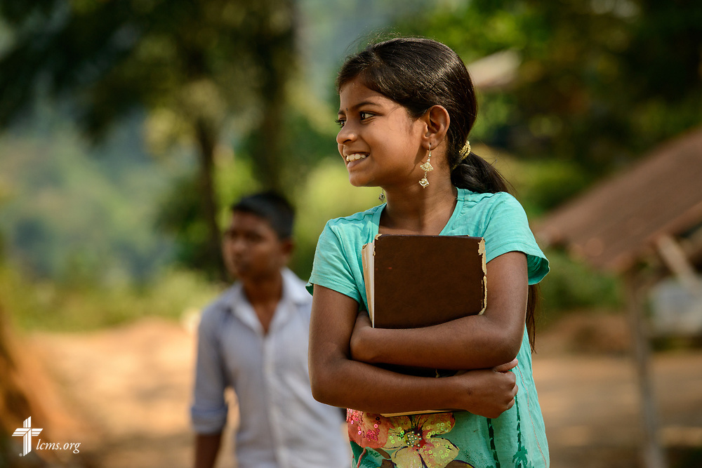 Young worshippers walk up the hill to service at the Eila rubber plantation in the Sabaragamuwa Province of Sri Lanka on Sunday, Jan. 21, 2018.  LCMS Communications/ Erik M. Lunsford