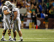 Washington's Drew Schaefer (73) reacts with teammate Danny Shelton after Washington lost a fumble near the end of the game against Baylor of the 2011 Valero Alamo Bowl at the Alamodome in San Antonio, Texas on Friday, Dec. 30, 2011. Baylor won 67-56.