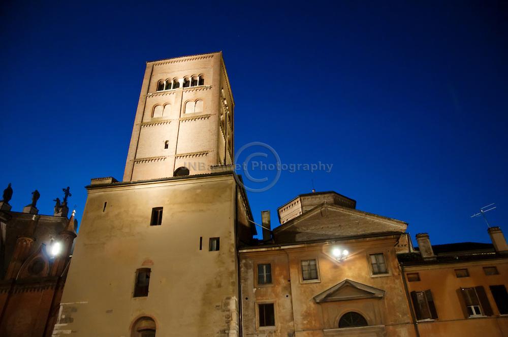 Evening illumination highlights historic architecture in Piazza Sordello - Mantua, Italy