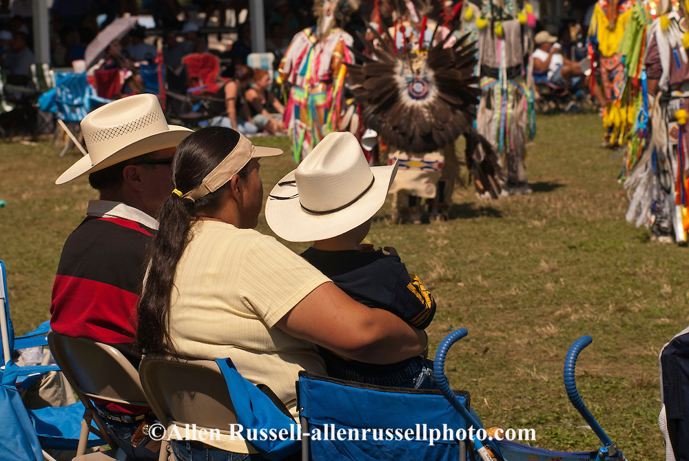 Native American family watches powwow, Crow Fair, Crow Indian Reservation, Montana