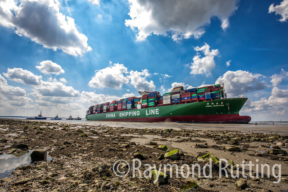 "Netherlands -Bath- "" A huge cargo ship has got stuck in the Western Scheldt. Traffic on the Scheldt Estuary was heavily disrupted, as only smaller cargo ships can pass to reach the port of Antwerp. A first attempt to get the ship going again, failed. A second attempt will be made at high tide, tonight around 8 o'clock. It seems the ship had a technical failure, going straight ahead in a curve where it had to go left, running aground at relatively high speed..The Stranded ship soon becomes tourist attraction. The ship measures 366 metres in length and can carry up to 155,000 tons. It got stuck in the vicinity of the Dutch town of Bath, on the north-east banks of the estuary, at a notorious section called the curve of Bath) "". foto raymond rutting"