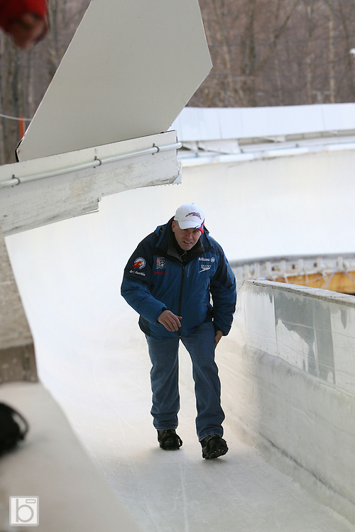 U.S. Bobsled Team Coach Tuffy LaTour walks the track at the Olympic Sports Complex Bobsled Track in Lake Placid, N.Y. in between training runs at the second annual Bodine Bobsled Challenge in Lake Placid, N.Y., Jan 4-6 2007.  NASCAR, BUSCH and NHRA drivers and personalities attended the event to benefit the Bo-Dyn Bobsled Project which was founded by Geoff Bodine to develop and produce competitive bobsled designs for the United States Bobsled Team.<br />