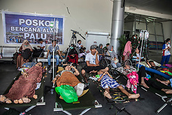 October 3, 2018 - Palu, Central Sulawesi, Indonesia - Earthquake and tsunami survivors rest as they wait to be transported by military planes at Mutiara Al Jufri Airport in Palu in Central Sulawesi, after an earthquake and tsunami on September 28. (Credit Image: © Ivan Damanik/ZUMA Wire)