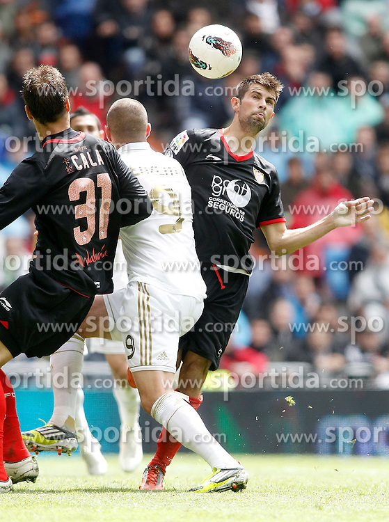 29.04.2012, Santiago Bernabeu Stadion, Madrid, ESP, Primera Division, Real Madrid vs FC Sevilla, 36. Spieltag, im Bild Real Madrid's Karim Benzema against Sevilla's Jorge Andujar Coke the football match of spanish 'primera divison' league, 36th round, between Real Madrid and FC Sevilla at Santiago Bernabeu stadium, Madrid, Spain on 2012/04/29. EXPA Pictures © 2012, PhotoCredit: EXPA/ Alterphotos/ Alvaro Hernandez..***** ATTENTION - OUT OF ESP and SUI *****