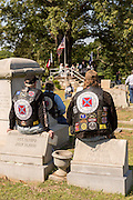 Bikers with the Confederate motorcycle club called the Mechanized Cavalry site on tombstones during a service at Elmwood Cemetery to mark Confederate Memorial Day May 2, 2015 in Columbia, SC. Confederate Memorial Day is a official state holiday in South Carolina and honors those that served during the Civil War.