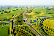 Nederland, Gelderland, Gemeente Zaltbommel, 23-08-2016; verkeersknooppunt Deil, A2 en A15  (vlnr) - parallel A2 de Betuweroute. Klaverturbineknooppunt.<br /> Deil junction, main motorway A15 Rotterdam Harbour - Germany crossing A2 to the South.<br /> <br /> aerial photo (additional fee required); <br /> luchtfoto (toeslag op standard tarieven);<br /> copyright foto/photo Siebe Swart