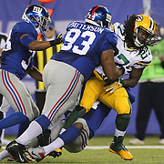Packers Eddie Lacy, is tackled by Mike Patterson, New York Giants, during the New York Giants Vs Green Bay Packers, NFL American Football match at MetLife Stadium, East Rutherford, New Jersey, USA. 17th November 2013. Photo Tim Clayton