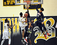 Willingboro's Julius Chamblo #14 blocks a shot by Bordertown's Myron Gordon #5 in the first quarter of the Willingboro vs Bordentown Central Jersey Group 3 boys basketball semifinal at Bordertown High School Saturday March 5, 2016 in Bordentown, New Jersey.  (Photo by William Thomas Cain)