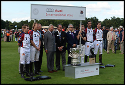 HRH The Prince of Wales with the winning team England after England beat The USA in the  Audi International Polo 2013-Westchester Cup Polo match Audi England v Equus & Co USA at the <br /> Guards Polo Club, Egham, United Kingdom,<br /> Sunday, 28th July 2013<br /> Picture by Andrew Parsons / i-Images