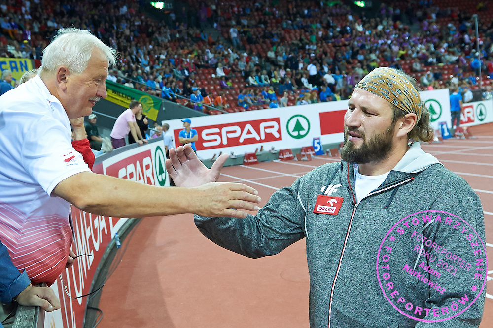 (R) Tomasz Majewski of Poland and (R) his trainer coach Henryk Olszewski while men's shot put final during the First Day of the European Athletics Championships Zurich 2014 at Letzigrund Stadium in Zurich, Switzerland.<br /> <br /> Switzerland, Zurich, August 12, 2014<br /> <br /> Picture also available in RAW (NEF) or TIFF format on special request.<br /> <br /> For editorial use only. Any commercial or promotional use requires permission.<br /> <br /> Photo by &copy; Adam Nurkiewicz / Mediasport