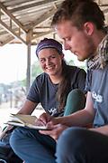 ICS volunteer Cara Mooney plans a teaching session with Graham Gilmor n the village of Banteay Char, near Battambang, Cambodia.