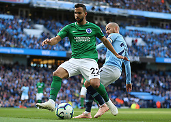 Manchester City's David Silva and Brighton & Hove Albion's Martin Montoya battle for the ball