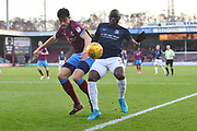 Southend United forward Marc-Antoine Fortune (9) and Scunthorpe United defender Cameron Burgess (21)during the EFL Sky Bet League 1 match between Scunthorpe United and Southend United at Glanford Park, Scunthorpe, England on 23 December 2017. Photo by Ian Lyall.