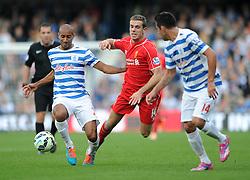 Liverpool's Jordan Henderson challenges for the ball with Queens Park Rangers's Karl Henry - Photo mandatory by-line: Dougie Allward/JMP - Mobile: 07966 386802 - 19/10/2014 - SPORT - football - London - Loftus Road - QPR v Liverpool - Barclays Premier League