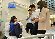 © Licensed to London News Pictures. 24/01/2013. London, UK (On Bed) Heather Murphy (L-R) Andy Burnham, Ed Miliband, Liz Kendall. Leader of the Labour Party, Ed Miliband, Shadow Health Secretary Andy Burnham and Health Minister Liz Kendall visit the Macmillan Cancer Centre at University College Hospital in Central London today, 24 January 2013. Today the Labour Party launched its Whole Person Care policy review. Photo credit : Stephen Simpson/LNP