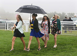 Soft underfoot for these four racegoers at a wet and windy opening day of Glorious Goodwood in the UK, Tuesday, 30th July 2013 <br /> Picture by Stephen Lock / i-Images