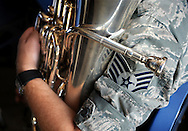 23 JUNE 2012 -- ST. LOUIS -- Missouri Air National Guard Staff Sgt. Devin Larue cradles his euphonium during a break in rehearsals for the 571st Air Force Band at Lambert Field in St. Louis Saturday, June 23, 2012. The group, which is attached to the 131st Fighter Wing of the Eighth Air Force, was organized in 1941 and has been based in St. Louis since 1946.  It is being hosting a final tour of the Midwest this summer, and will be decommissioned in September 2013. Photo © copyright 2012 Sid Hastings.
