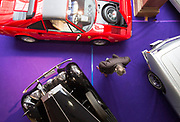 UNITED KINGDOM, London: 24 April 2018 A visitor makes his way through a selection of classic cars in The Royal Horticultural Halls, Westminster.. The car forms part of the Spring Classics: An Important Auction of Fine Historic Automobiles at The Royal Horticultural Halls, Westminster. The auction will see a collection of privately owned cars be auctioned this evening April 24th 2018. Rick Findler  / Story Picture Agency