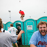 An infield partier lost a little dignity along with his pants as he dodged beer cans thrown at him as he runs across a line of portable restrooms and a gauntlet of projectiles during the 136th running of the Kentucky Derby at Churchill Downs Saturday May 1, 2010. Photo by David Stephenson