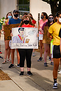 """30 JULY 2020 - DES MOINES, IOWA: A group of students walk up Grand Ave. to the Governor's Mansion in Des Moines. About 45 high school students from across Des Moines marched from downtown to the Governor's Mansion to protest Iowa Governor Kim Reynolds' proclamation ordering Iowa schools to reopen to in person classes despite the COVID-19 pandemic. The students stood in front of the mansion and chanted before staging a """"die  in"""" in the street. The Governor's order mandates in person instruction rather than on line or a mix of on line and in person. Several school districts have indicated that they will disregard the Governor's orders and reopen with a hybrid system or mostly on line. The Governor will allow districts to apply for a waiver if the Coronavirus (SARS-CoV-2) infection rate is more than 15% in their community.      PHOTO BY JACK KURTZ"""