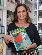 Cindy Puryear poses for a photograph in the leveled reading library at Roberts Elementary School, June 10, 2014.