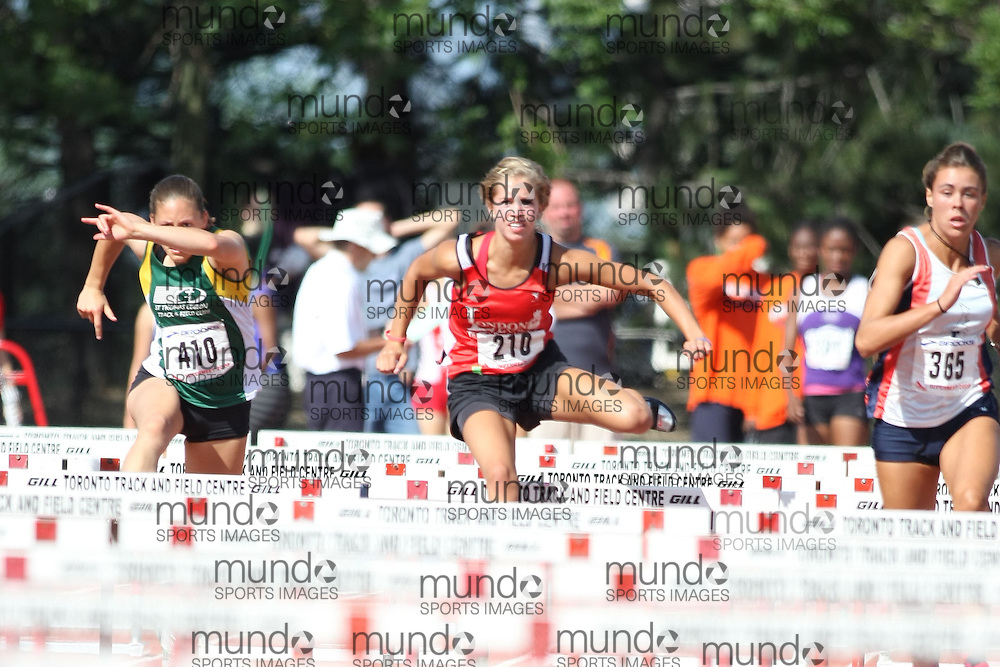 (Toronto, Ontario---3 August 2008)  Julia Hayman and  Charlotte Crombeen competing in the 100m hurdles at the 2008 OTFA Supermeet II, the Bantam, Midget, Youth Track and Field Championships. This image is copyright Sean W. Burges, and the photographer can be contacted at www.msievents.com.