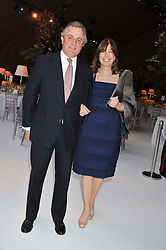 VISCOUNT & VISCOUNTESS ASTOR at a dinner hosted by Cartier following the following the opening of the Chelsea Flower Show 2012 held at Battersea Power Station, London on 21st May 2012.