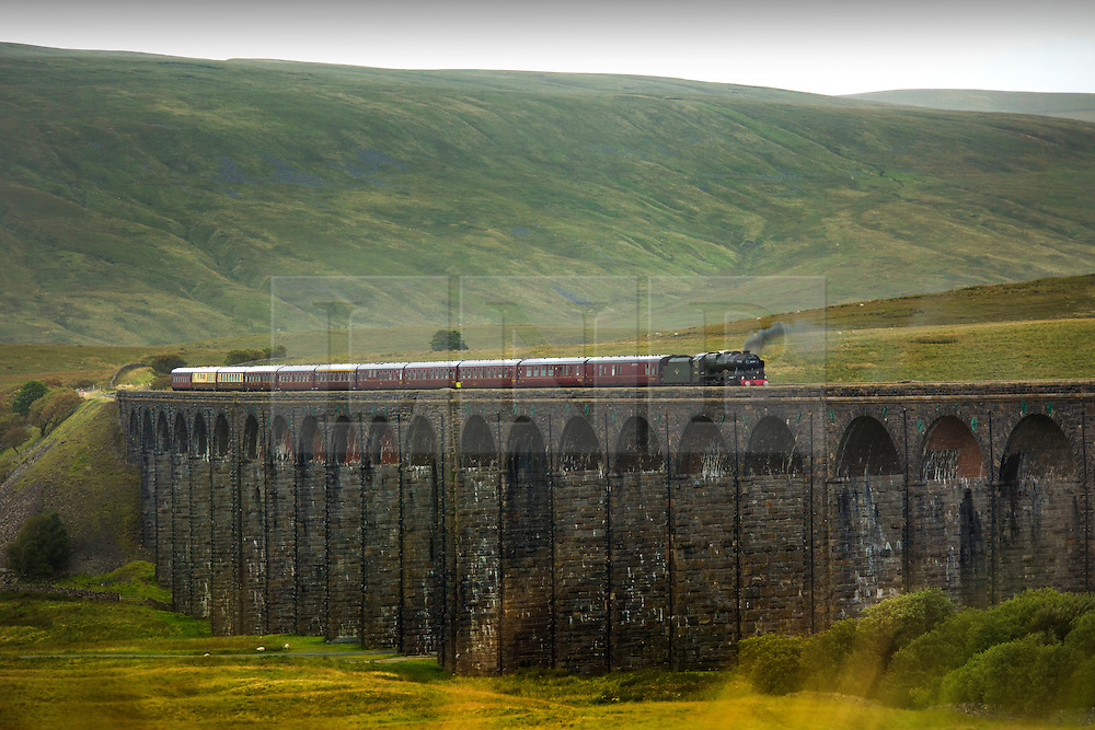 © Licensed to London News Pictures. 26/08/2015. Ribblehead, UK. Picture shows the Fellsman steam train 46115 making it's final crossing of the Ribblehead Viaduct for the season in The Yorkshire Dales.Photo credit: Andrew McCaren/LNP